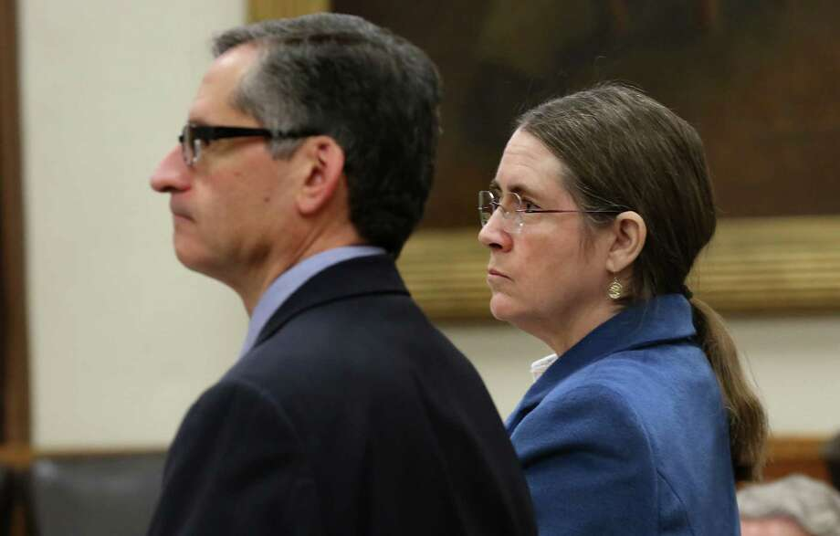 Renee Benson is shown with her lawyer Bennett Stahl during a February hearing. Wednesday's decision was a victory for her. Photo: Bob Owen /San Antonio Express-News / ©2015 San Antonio Express-News