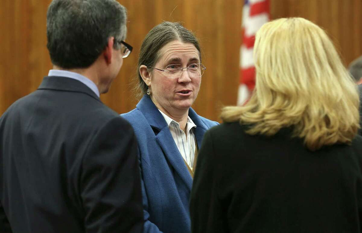 Renee Benson (center) talks with her lawyers Bennett Stahl and Emily Harrison Liljenwal during the February hearing in Bexar County Probate Court. On Friday, she asked the Fourth Court of Appeals to uphold a Bexar County probate court ruling in February that removed Tom Benson as trustee of his first wife's trust.