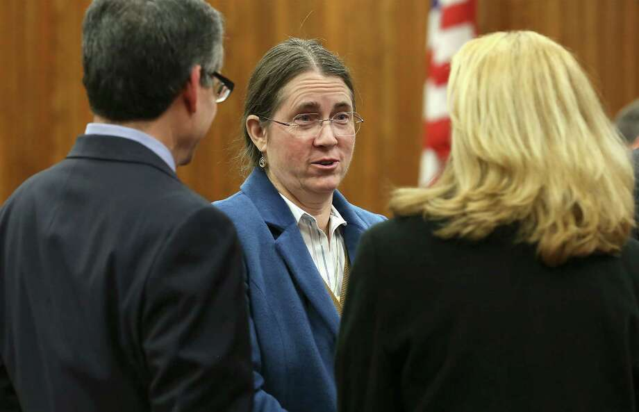 Renee Benson (center) talks with her lawyers Bennett Stahl and Emily Harrison Liljenwal during the February hearing in Bexar County Probate Court. On Friday, she asked the Fourth Court of Appeals to uphold a Bexar County probate court ruling in February that removed Tom Benson as trustee of his first wife's trust. Photo: Bob Owen /San Antonio Express-News / ©2015 San Antonio Express-News