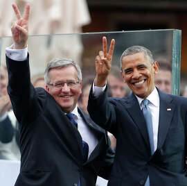 President Obama (right) and Polish President Bronislaw Komorowski attend the 25th anniversary celebration of free elections in Poland.