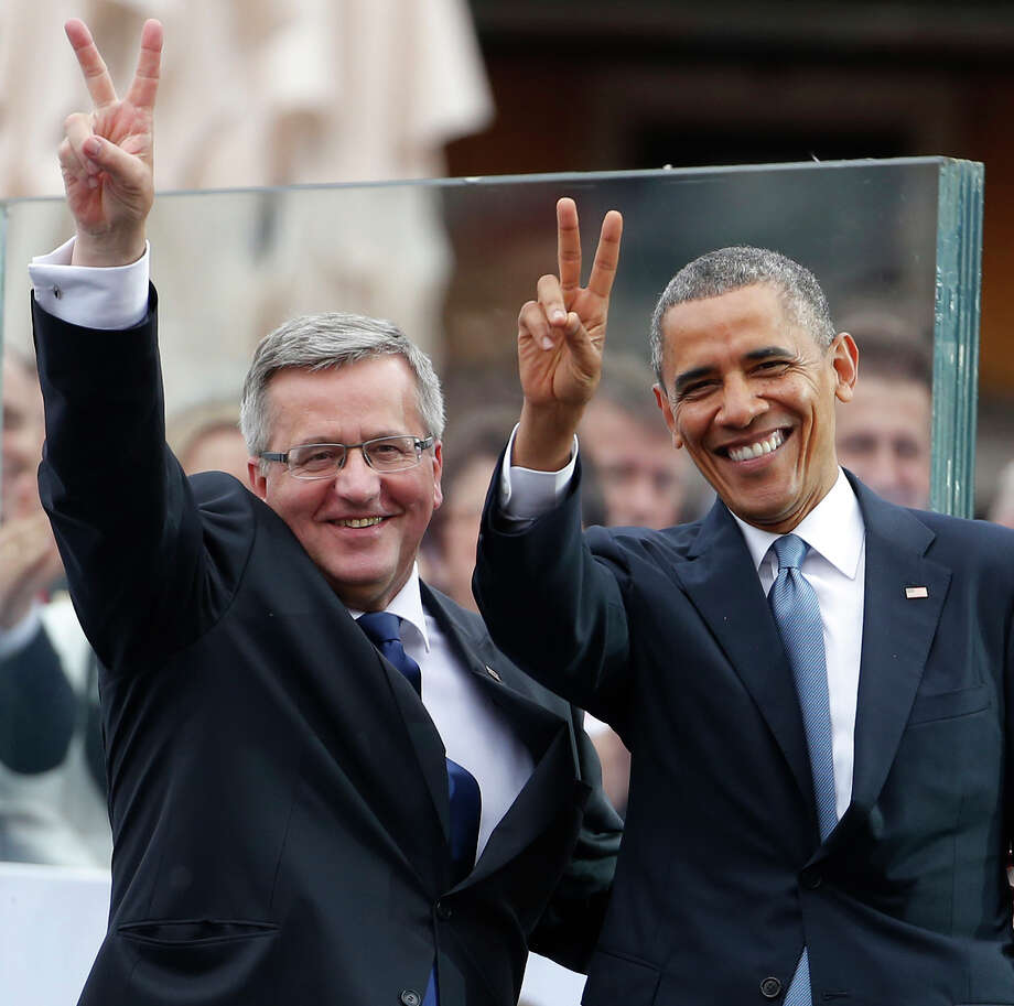 President Obama (right) and Polish President Bronislaw Komorowski attend the 25th anniversary celebration of free elections in Poland. Photo: Charles Dharapak / Associated Press / AP