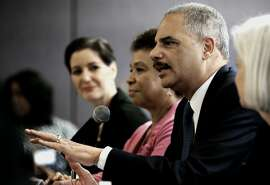 Oakland Mayor Libby Schaaf, (left) and Congresswoman Barbara Lee join U.S. Attorney General Eric Holder and U.S. Attorney Melinda Haag, (right) as he meets with local politicians and community leaders for a round table discussion about improving relationships between law enforcement and communities, at the Ron Dellums Federal Building in Oakland, Ca., on Thursday Feb. 5, 2015.