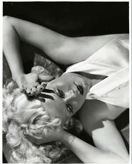"""Among the many glamour photos that George Hurrell took in Hollywood in the 1930s and '40s is this 1933 portrait of Jean Harlow. The photo is part of the new exhibition """"Lights! Camera! Glamour! The Photography of George Hurrell"""" at the Walt Disney Family Museum through June 29. Courtesy of Pancho Barnes Trust Estate Archive © Estate of George Hurrell"""