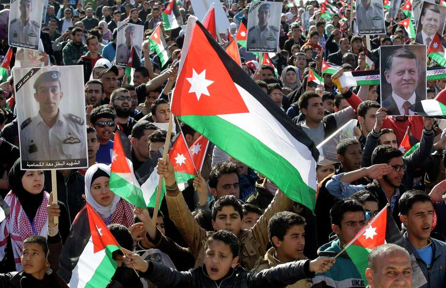 Jordanian students wave national flags during a rally in Amman against the Islamic State. Photo: KHALIL MAZRAAWI / AFP / Getty Images / AFP