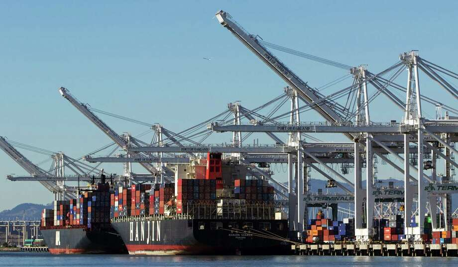 Ships dock at the Port of Oakland last month. Traffic continues to back up at ports along the West Coast as talks to reach of contract go on. Photo: Santiago Mejia / The Chronicle / ONLINE_YES