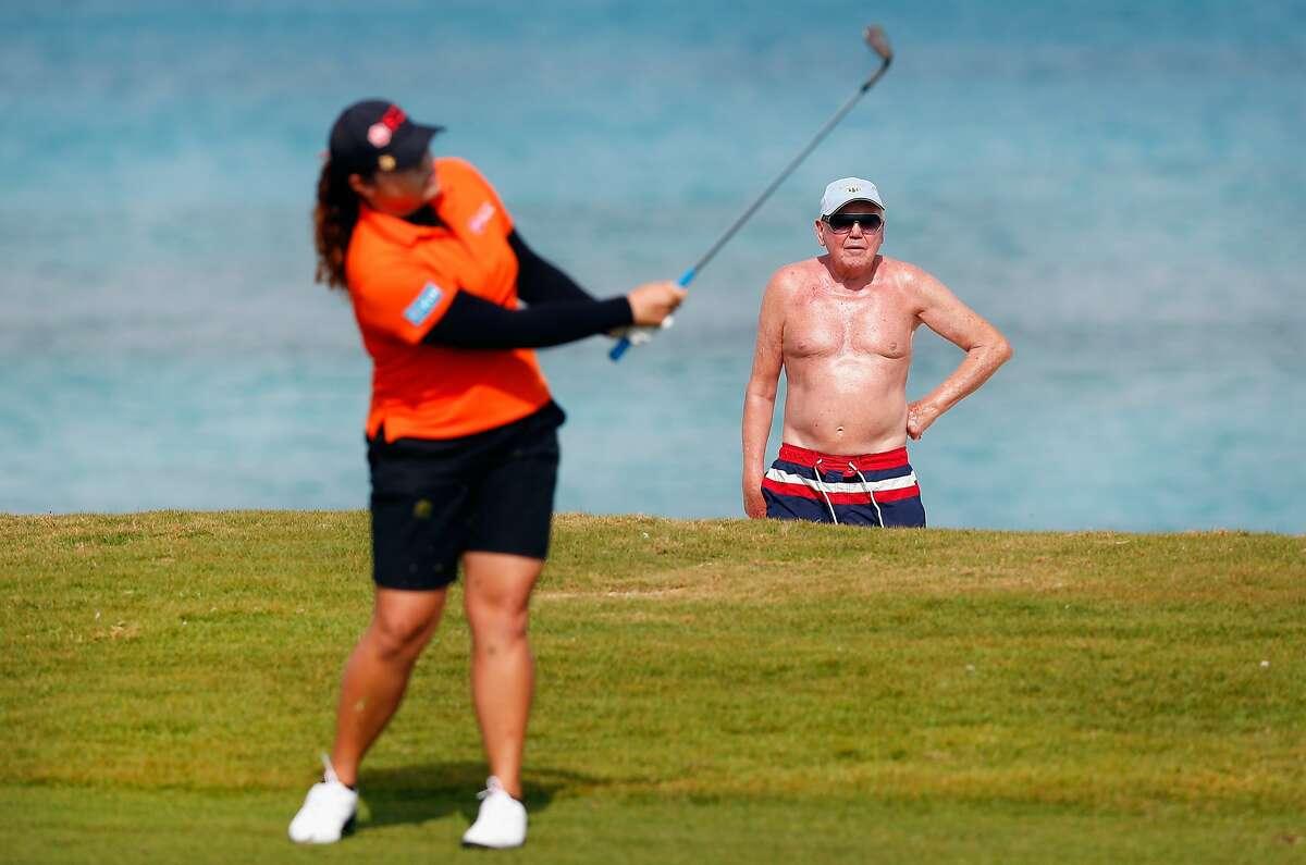 HAVING AVOIDED a sand bunker and the old-man-without-a-shirt hazard, Ariya Jutanugarn of Thailand hits a iron shot on the eighth hole at the Pure Silk Bahamas LPGA Classic on Paradise Island, Bahamas.