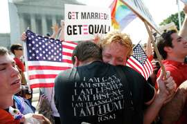 Michael Knaapen (left) and his husband, John Becker, embrace outside the U.S. Supreme Court in Washington after the court struck down a federal provision in 2013 denying benefits to legally married gay couples. Americans narrowly favor allowing same-sex couples in their states to legally marry, a new Associated Press-GfK poll finds. But that support comes with caveats, and there is a close division in the country over the upcoming Supreme Court case that could make same-sex marriage legal nationwide.