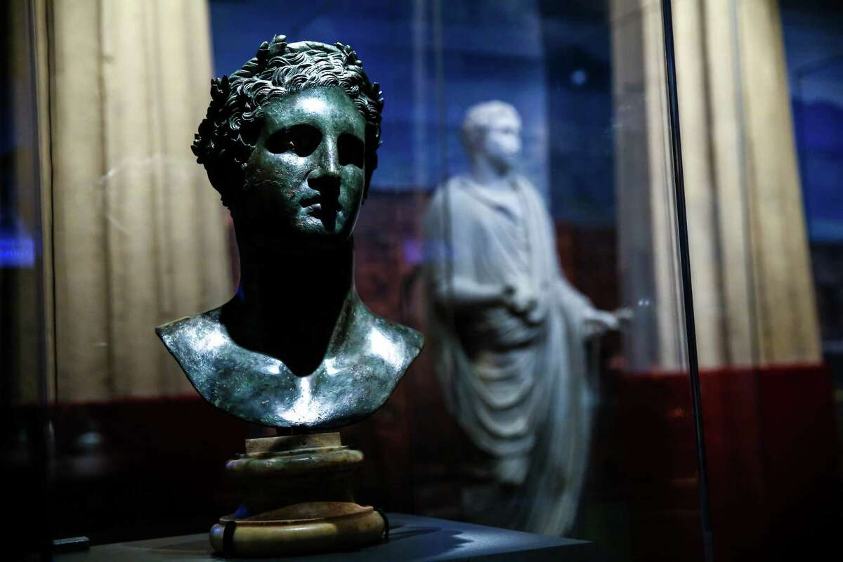 A bronze bust of Ptolemy II Philadelphus is shown during a press preview of POMPEII: The Exhibition at the Pacific Science Center on Thursday, February 5, 2015. The exhibit brings artifacts from the city that was covered with ash after an eruption of Mount Vesuvius 2,000 years ago.