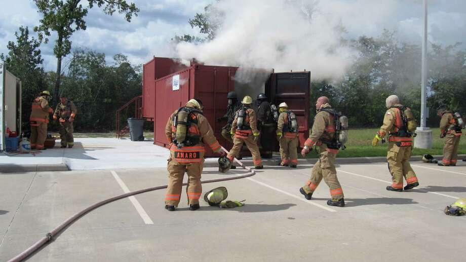 Fire science technology instructors at Lone Star College-Montgomery train in the college's newly acquired class A flashover chamber.
