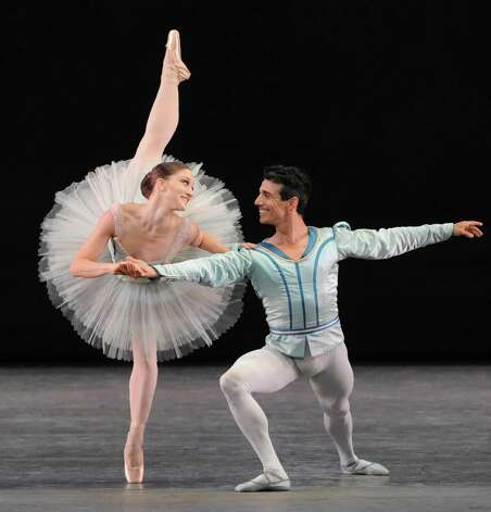 Principal dancers Asley Bouder and Joaquin De Luz dance ,Raymonda Variations, on the opening night of the New York City Ballet at SPAC  on Tuesday July 8, 2014 in Saratoga Springs, N.Y. (Michael P. Farrell/Times Union) Photo: Michael P. Farrell / 00027631A