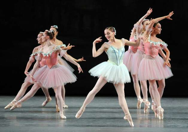 Principal dancer Asley Bouder, center, dances ,Raymonda Variations, on the opening night of the New York City Ballet at SPAC  on Tuesday July 8, 2014 in Saratoga Springs, N.Y. (Michael P. Farrell/Times Union) Photo: Michael P. Farrell / 00027631A