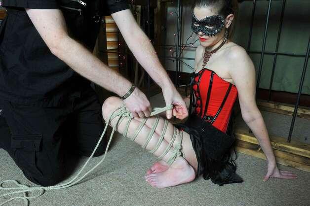 Cassavini and Julia a BDSM couple on Wednesday Feb. 4, 2015 in Bennington, VT. Cassavini demonstrates Shibari rope tying on Julia. (Michael P. Farrell/Times Union) Photo: Michael P. Farrell / 00030452A