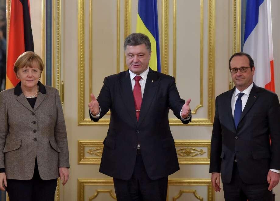 Ukrainian President Petro Poroshenko, center, German Chancellor Angela Merkel and French President Francois Hollande meet in Kiev, Ukraine. Photo: Mykola Lazarenko / Associated Press / Presidential Press Service
