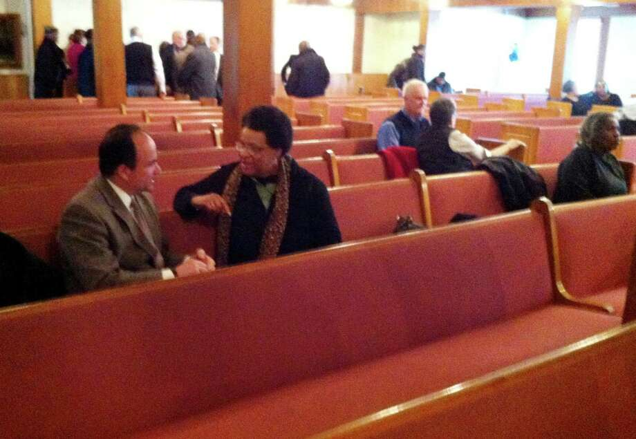 Ex-Mayor-turned-felon Joseph Ganim chats with Rosaline Mallory Thursday morning, Feb. 5, 2015 at East End Baptist Church in Bridgeport, Conn. Ganim, who is weighing running for his old job, was there to support a proposal by Gov. Dannel Malloy that will help non-violent offenders return to society. Photo: Brian Lockhart / Connecticut Post