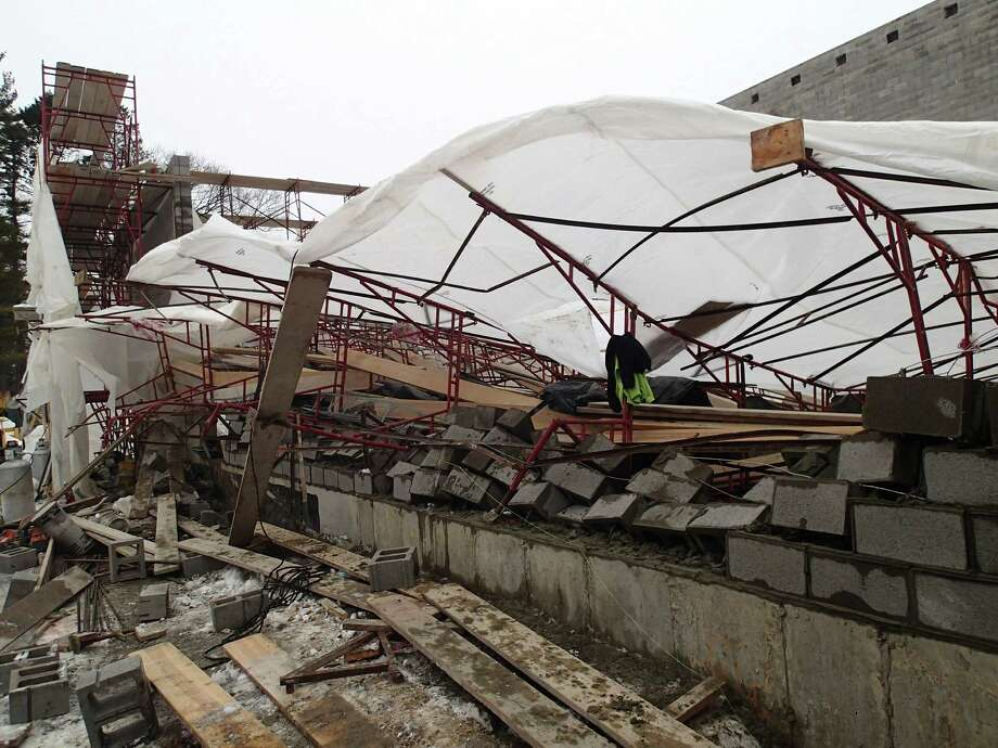 Three construction workers were hospitalized for non-life-threatening injuries Thursday morning after scaffolding collapsed on them at Greens Farms Academy. Photo: Westport Fire Department / Westport News