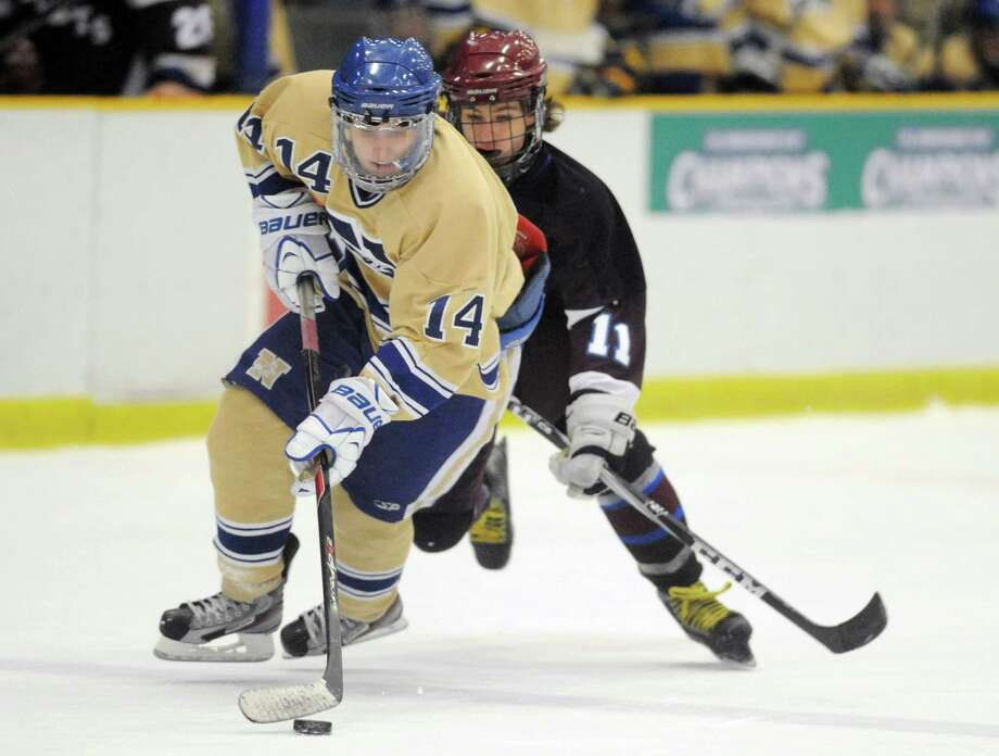 Newtown's Jonathan Lovorn (14) makes a move past Brookfield/Bethel/Danbury's Will Lawrence (11) in Newtown's 3-1 win over Brookfield/Bethel/Danbury in the high school hockey game at Danbury Arena in Danbury, Conn. on Saturday, Jan. 25, 2014. Photo: Tyler Sizemore / The News-Times
