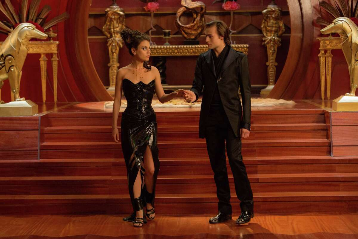 """This photo provided by Warner Bros. Pictures shows, Mila Kunis , left, as Jupiter Jones, and Douglas Booth as Titus Abrasax, in Warner Bros. Pictures' and Village Roadshow Pictures' """"Jupiter Ascending,"""" an original science fiction epic adventure from Lana and Andy Wachowski. The movie is a Warner Bros. Pictures release. (AP Photo/Warner Bros. Pictures, Murray Close) ORG XMIT: CAET596"""