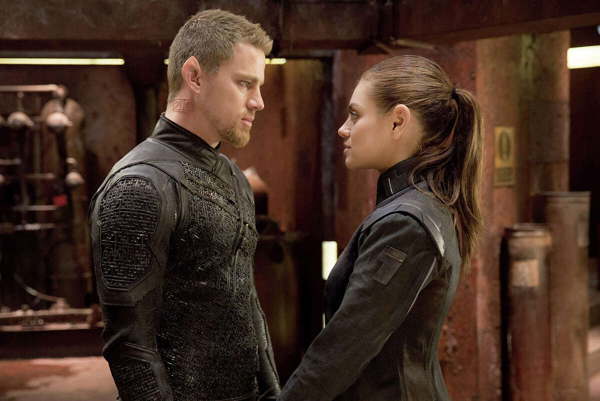 """(L-r) Channing Tatum as Caine Wise and Mila Kunis as Jupiter Jones in """"Jupiter Ascending.?"""" Illustrates FILM-JUPITER-ADV06 (category e), by Stephanie Merry © 2015, The Washington Post. Moved Wednesday, Feb. 4, 2015. (MUST CREDIT: Murray Close/Warner Bros. Entertainment.)"""