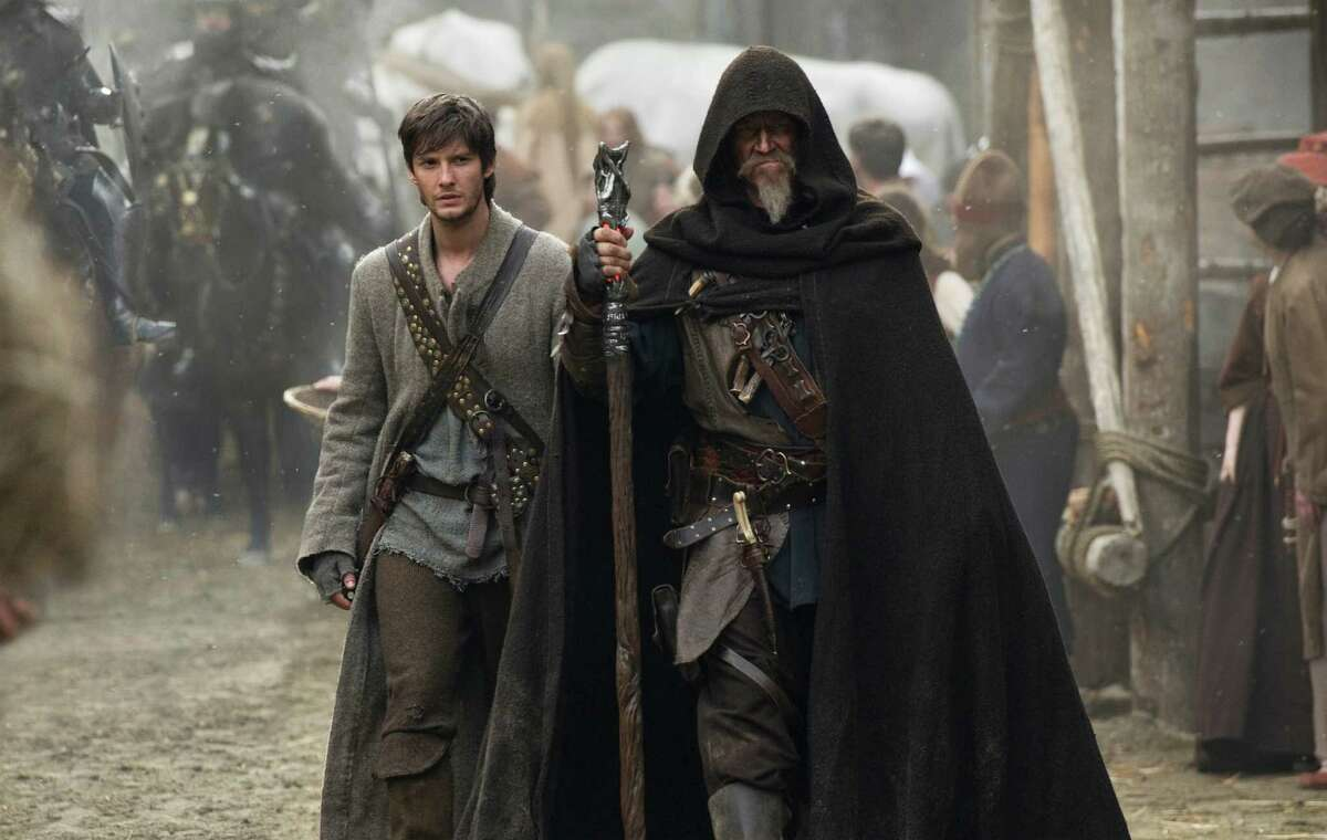 """This image released by Universal Pictures shows Ben Barnes, left, and Jeff Bridges in a scene from """"Seventh Son."""" (AP Photo/Legendary Pictures and Universal Pictures) ORG XMIT: NYET323"""
