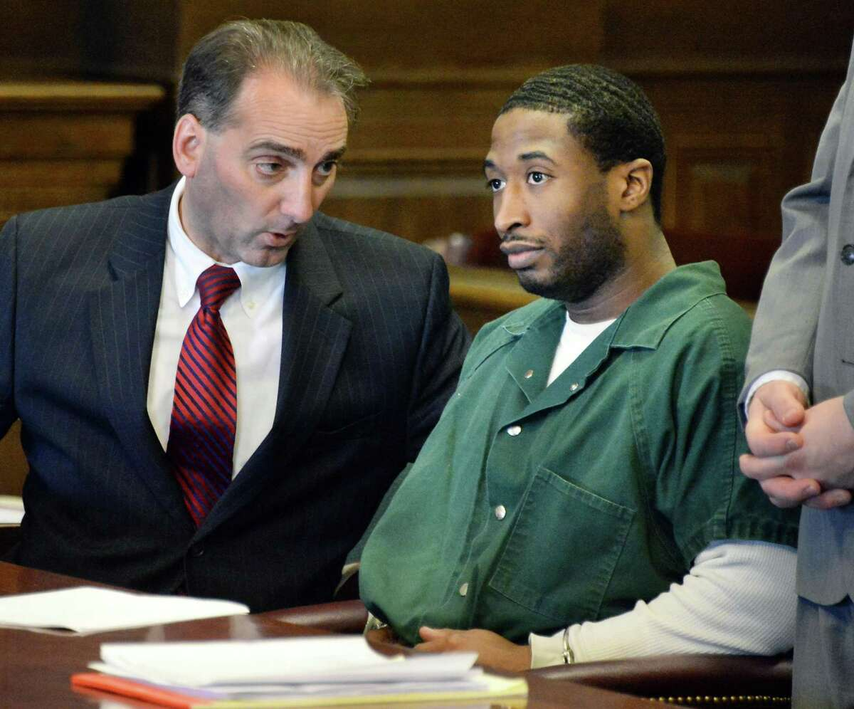 Rensselaer County Public Defender John Turi, left, confers with defendant Paul Walker during an appearance before Judge Andrew Ceresia Thursday, Feb. 5, 2015, at the Rensselaer County Courthouse in Troy, N.Y. (John Carl D'Annibale / Times Union)