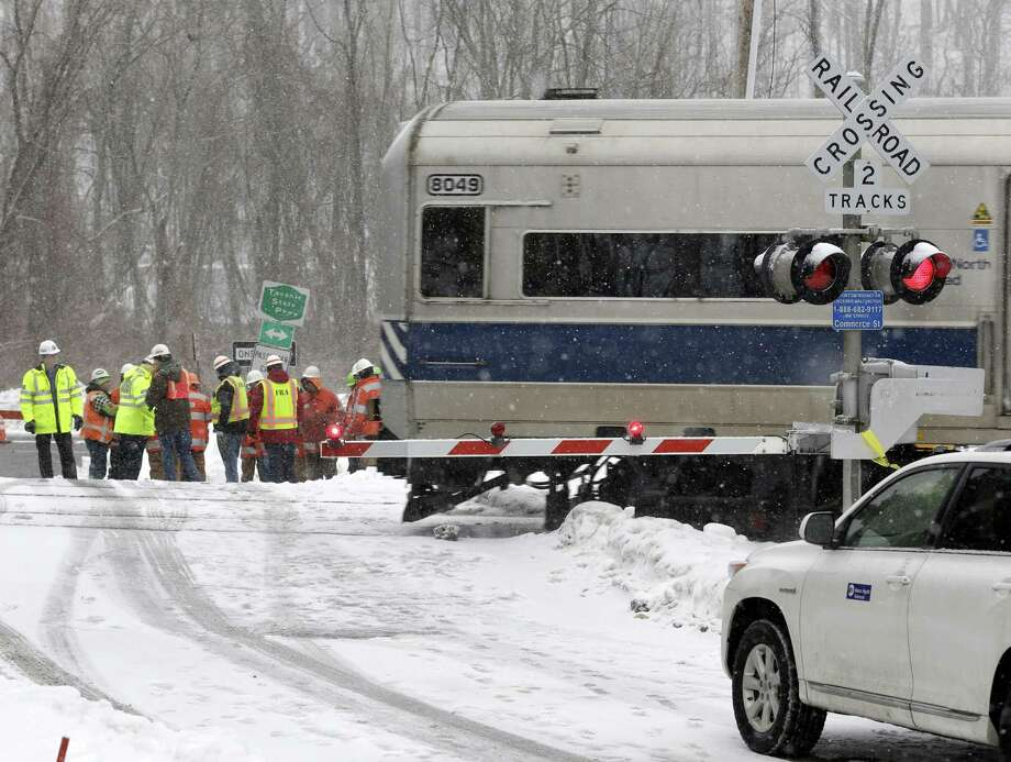 A Metro-North Railroad train passes through the intersection that was the site of a fatal collision between an SUV and a commuter train in Valhalla, N.Y., Thursday, Feb. 5, 2015. An investigation into what caused a fiery crash that killed a motorist and five rail riders is focusing on how a mother of three described by friends as safety conscious ended up between two crossing gates in her SUV as a commuter train barreled toward her. Photo: Seth Wenig, AP Photo/Seth Wenig / Associated Press AP Photo/Seth Wenig