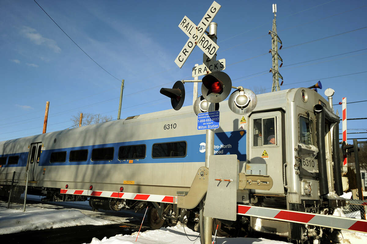 A southbound Metro-North train pull through the rail crossing into the Wilton Train Station in Wilton, Conn. on Thursday, February 5, 2015.