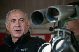 Israel's Prime Minister Benjamin Netanyahu visits at a military outpost during a visit at Mount Hermon in the Israeli-controlled Golan Heights overlooking the Israel-Syria border on Wednesday, Feb. 4, 2015.