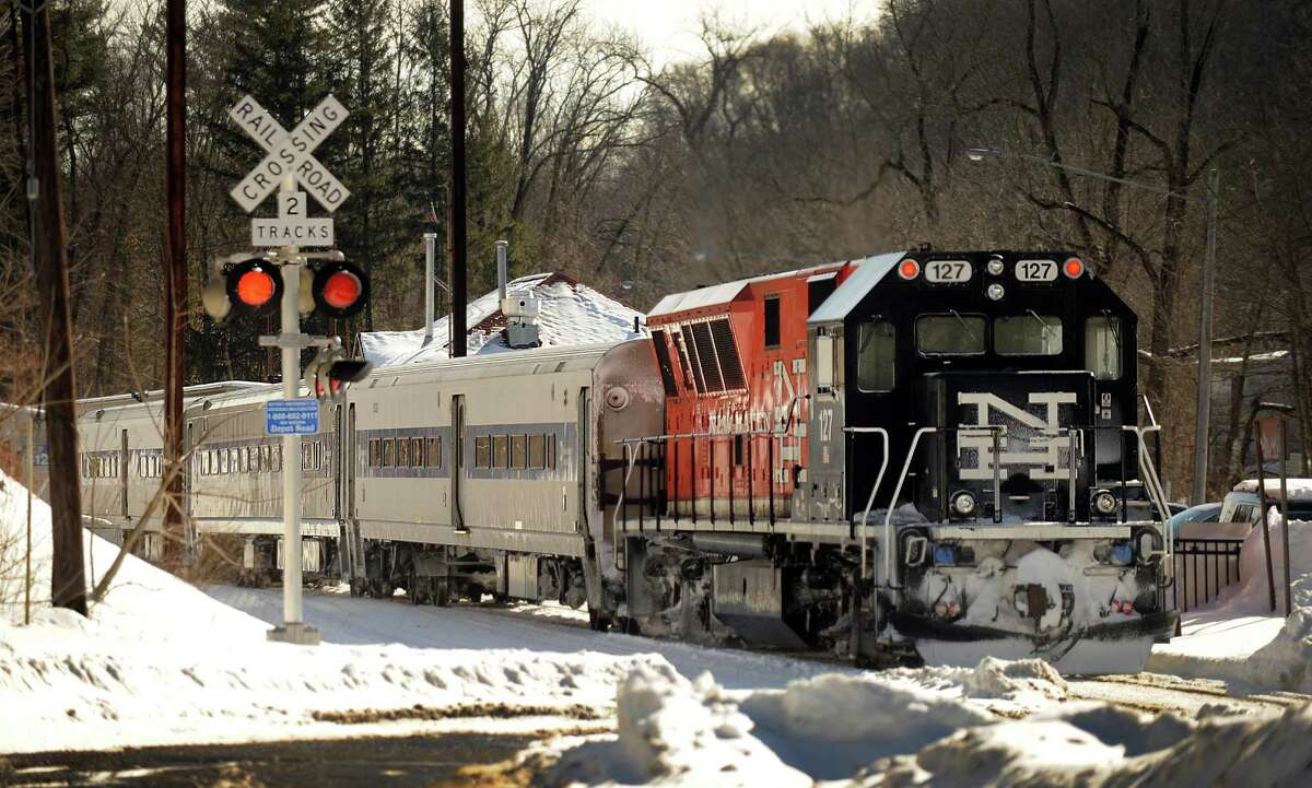A train crosses Depot Road as it pulls into the Branchville Station in the Branchville section of Ridgefield, Conn., Thursday, February 5, 2015.