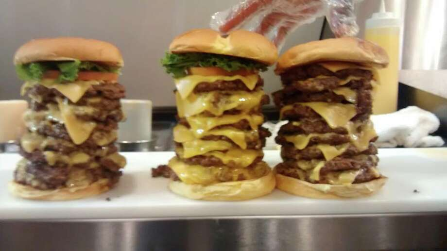 The Triple Triple Burger from Wayback Burgers consists of nine patties and nine slices of cheese. Photo: Wayback Burgers
