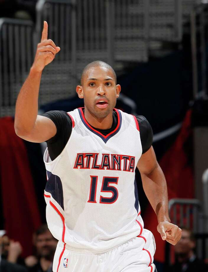 Hawks center Al Horford, an All-Star, has led an extremely team-oriented system that has Atlanta on course for a franchise-record win total. Photo: Kevin C. Cox / Getty Images / 2015 Getty Images