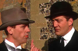 """Hugh Laurie (left) and Stephen Fry in the TV series """"Jeeves & Wooster."""""""