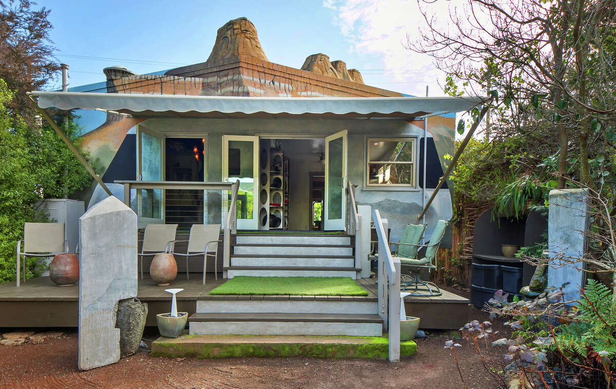The back patio of the Spanish Bungalow is fashioned after an Airstream travel trailer and the yard hosts a Southwestern motif.