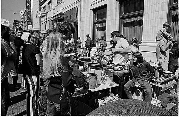 MOHAI caption: Pottery booth at University District street fair, Seattle, 1971