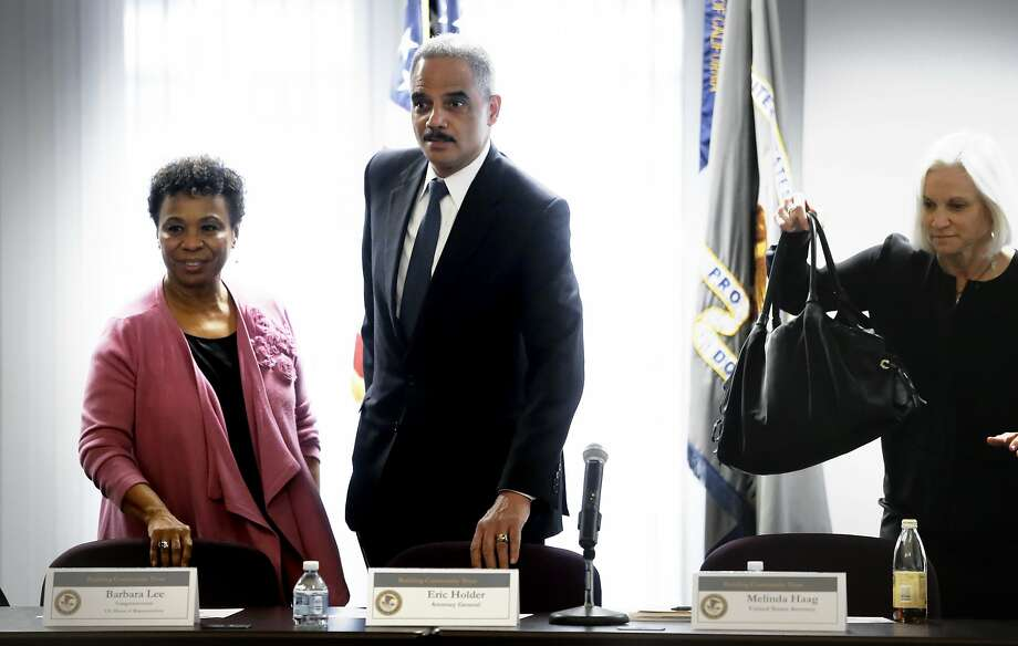 U.S. Attorney General Eric Holder is joined by Congresswoman Barbara Lee, (left) and U.S. Attorney Melinda Haag, as they begin a meeting with with local politicians and community leaders for a round table discussion about improving relationships between law enforcement and communities, at the Ron Dellums Federal Building in Oakland, Ca., on Thursday Feb. 5, 2015. Photo: Michael Macor, The Chronicle
