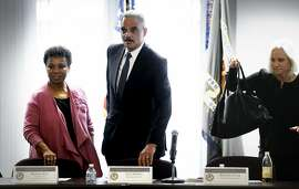 Above: U.S. Attorney General Eric Holder, Rep. Barbara Lee (left) and U.S. Attorney Melinda Haag begin a meeting about improving relations between law enforcement and communities.