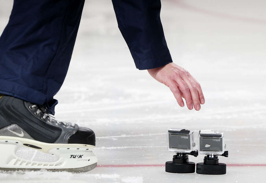 A GoPro Hero4 is used to capture action at an event during the NHL All-Star weekend last month. The cameras are popular with sports enthusiasts. Photo: Bruce Bennett / Getty Images / 2015 Getty Images