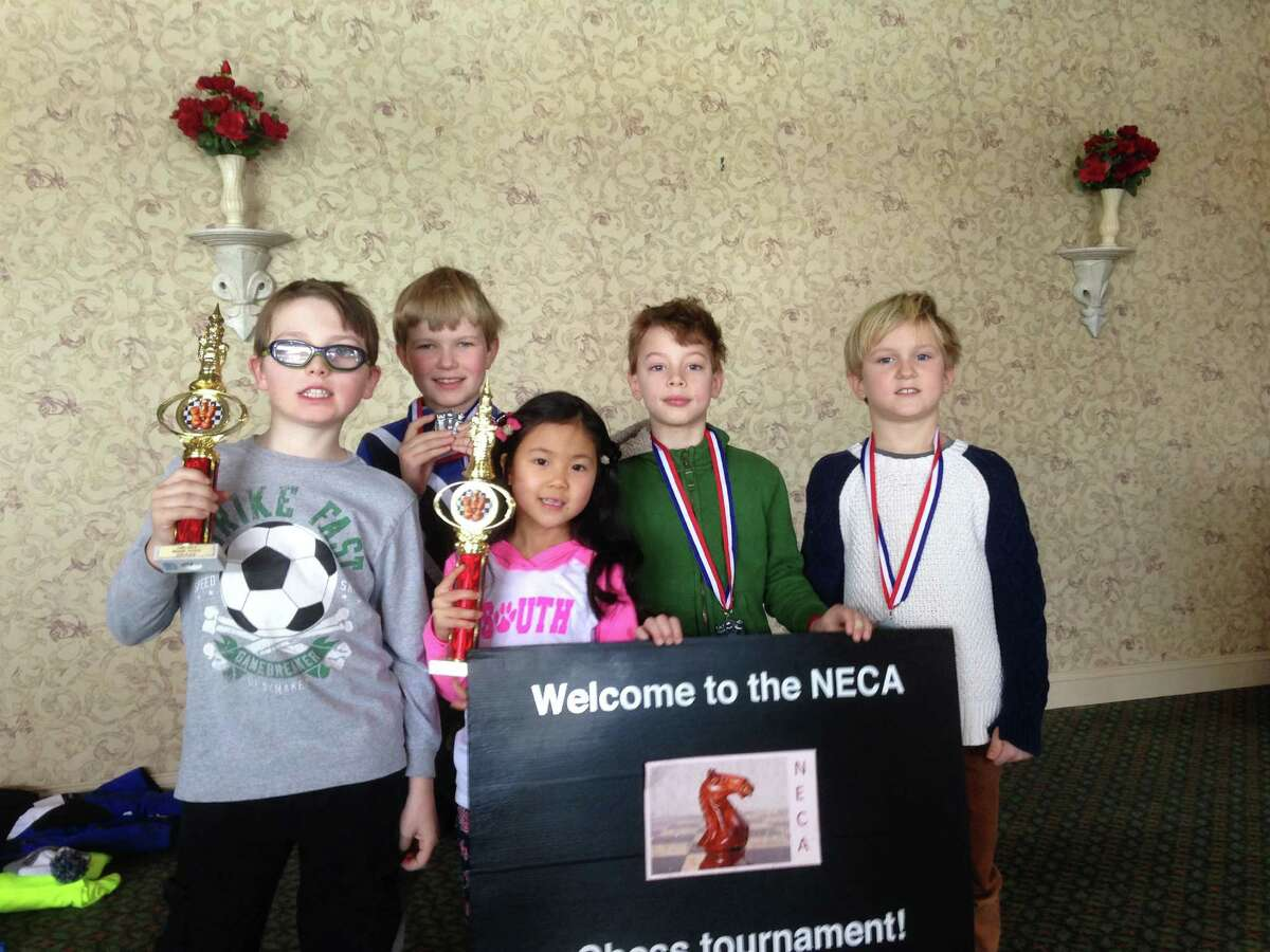 South School Chess Club members Luke Van Dussen, Thomas Crehan, Jenna Ho, Henry Chandra and William Cox show off the trophies they won at the recent National Education Chess Association (NECA) tournament in Stamford.