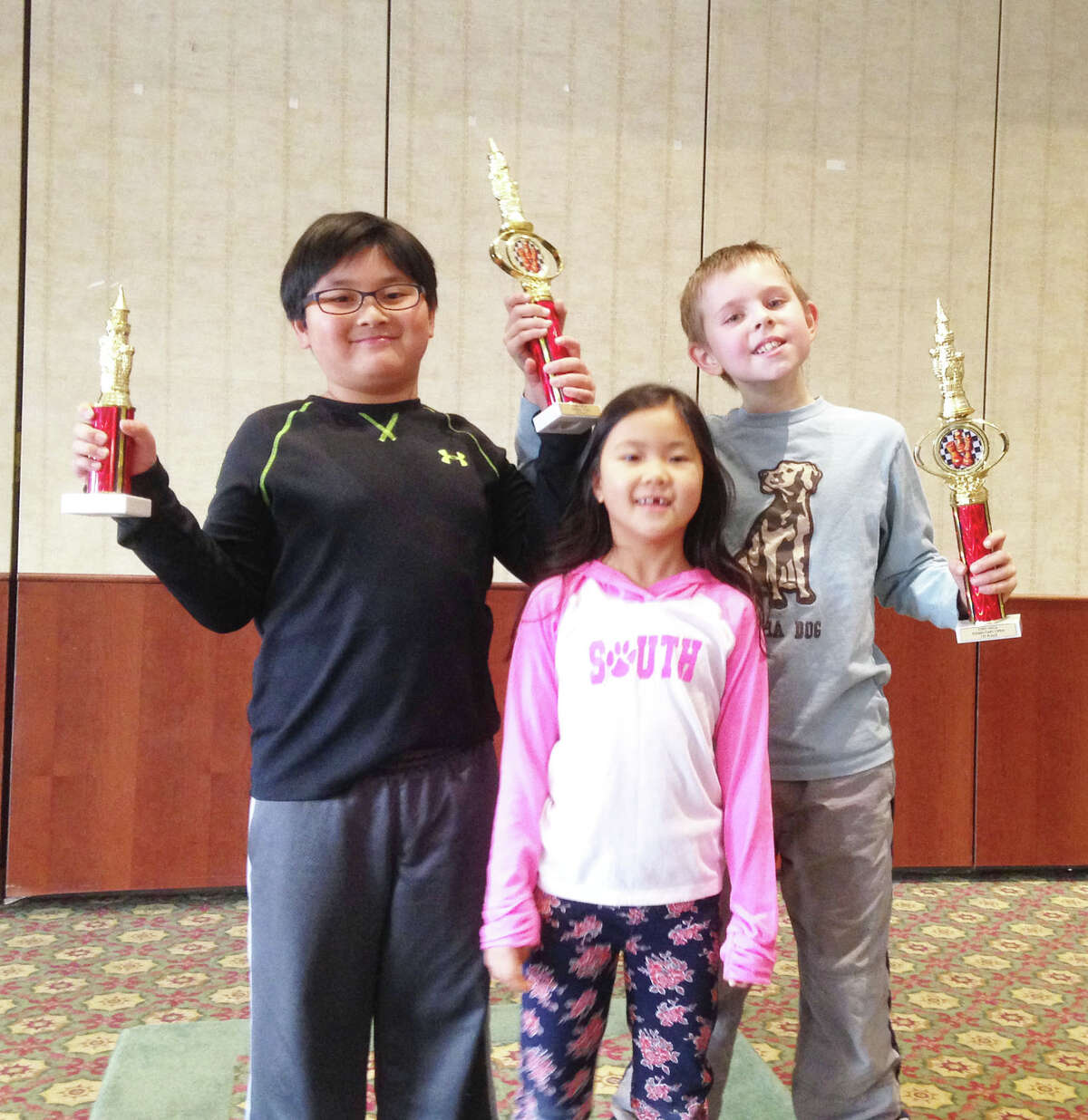 Among the contributors to the South Elementary School Chess Club's first place finish at a recent National Education Chess Association (NECA) tournament in Stamford were Joseph Ho, Jenna Ho, and Nathaniel Moor.