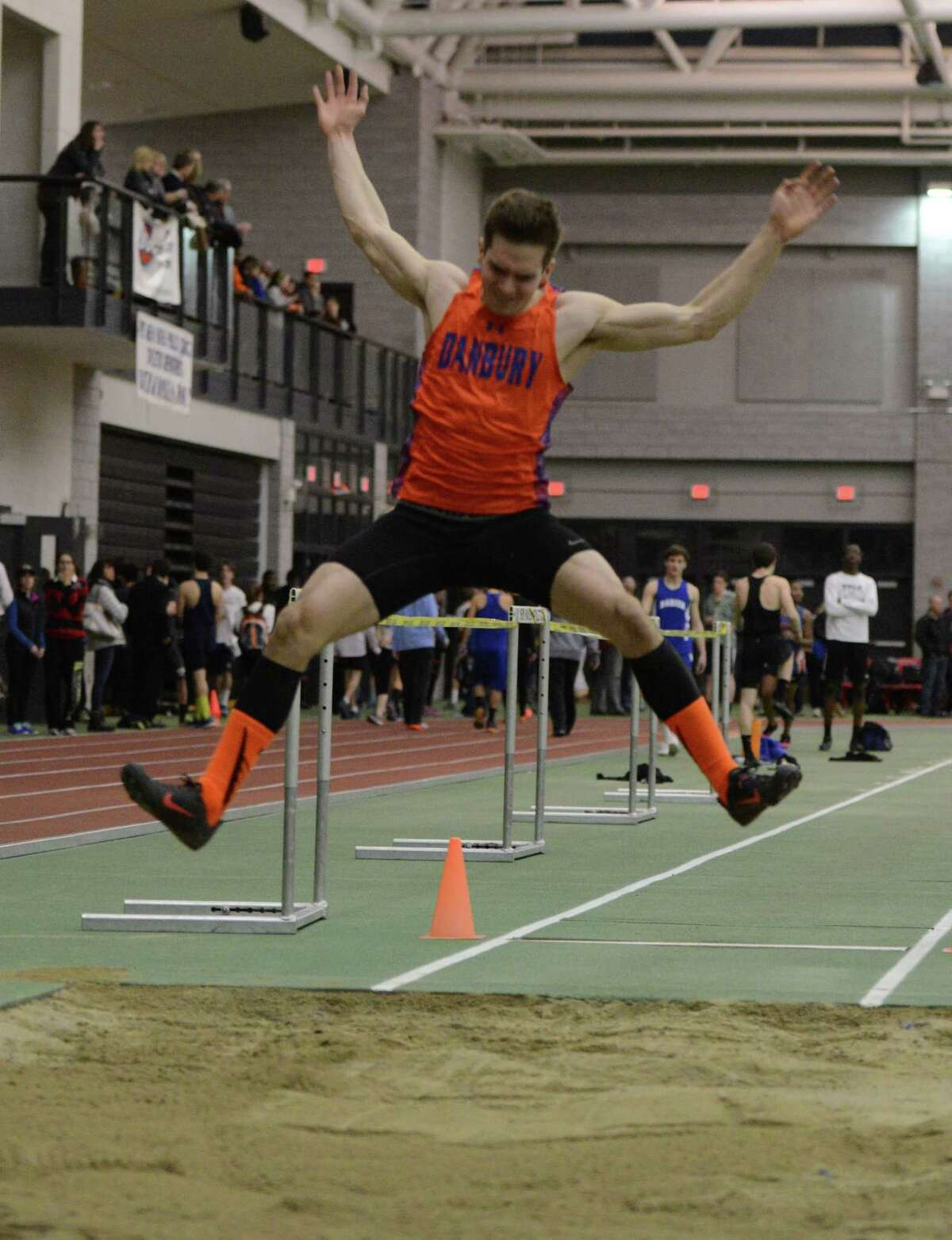 Danbury's Mike Morrow competes in the long jump event Thursday, Feb. 5, 2015, during the FCIAC boys and girls indoor track and field championhsips at the Floyd Little Athletic Center in New Haven, Conn.