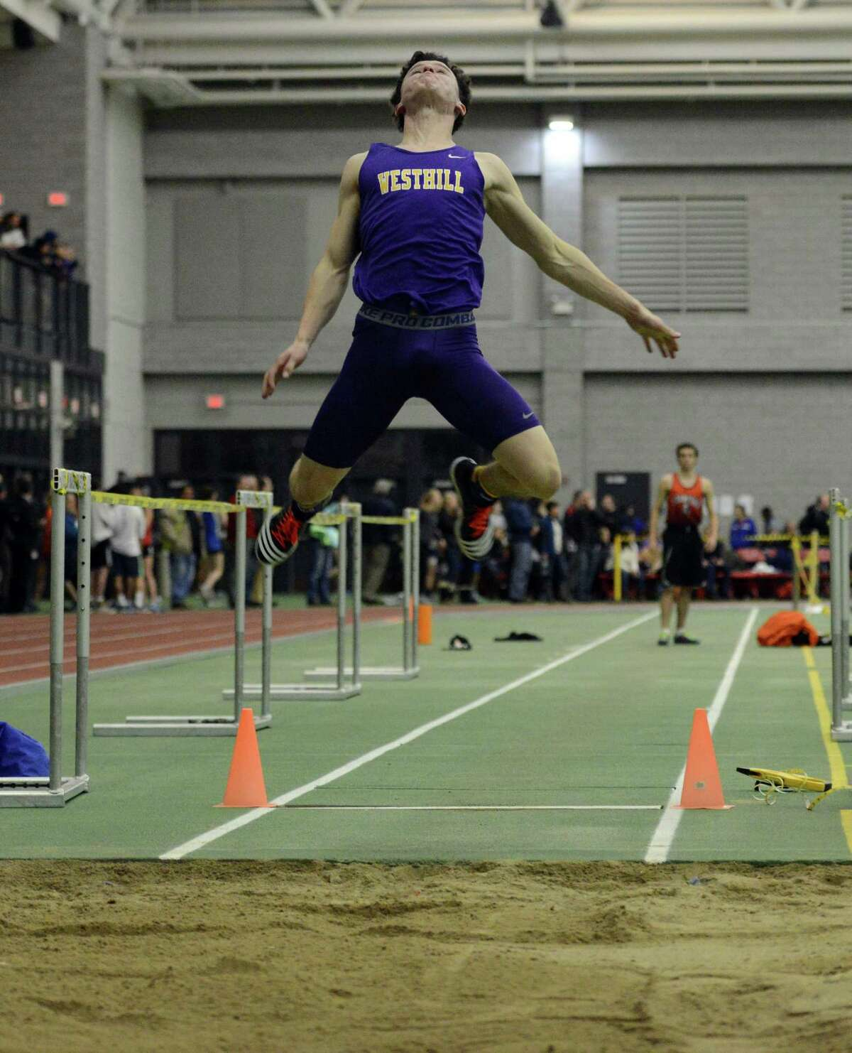 Westhill's Chris Rough competes in the long jump event Thursday, Feb. 5, 2015, during the FCIAC boys and girls indoor track and field championhsips at the Floyd Little Athletic Center in New Haven, Conn.
