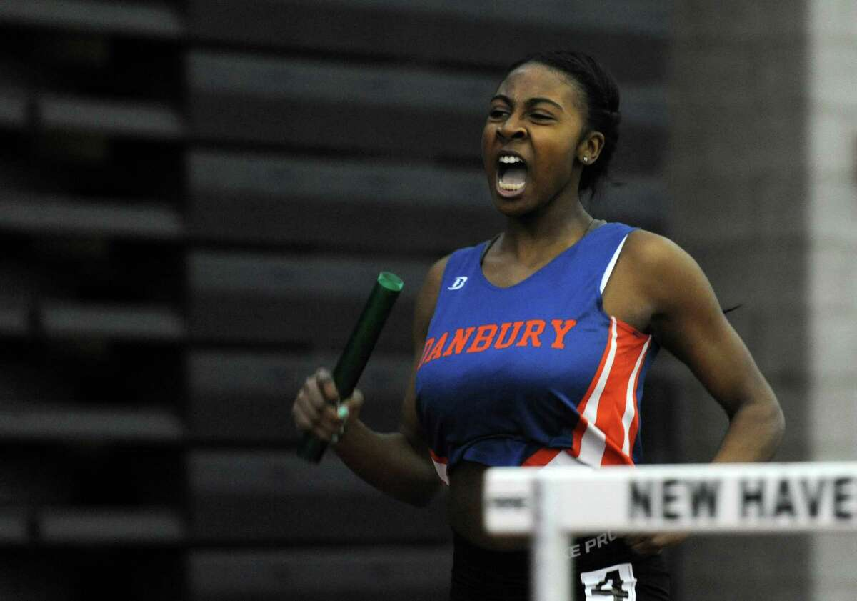Danbury's Zyniah Bunn races in the 4x200 meter relay Thursday, Feb. 5, 2015, during the FCIAC boys and girls indoor track and field championhsips at the Floyd Little Athletic Center in New Haven, Conn.