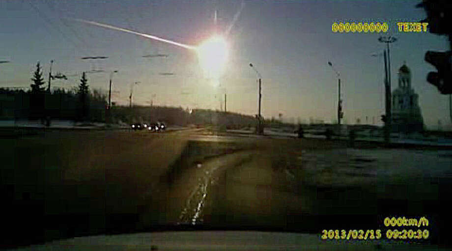In this image from a dashboard camera video, a meteor streaks across the sky in Russia in 2013. Photo: Uncredited / Associated Press / AP Video