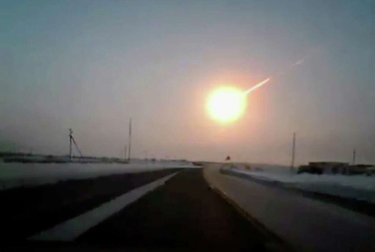 In this frame grab made from a video done with a dashboard camera, on a highway from Kostanai, Kazakhstan, to Chelyabinsk region, Russia, provided by Nasha Gazeta newspaper, on Friday, Feb. 15, 2013 a meteorite contrail is seen. A meteor streaked across the sky of Russia's Ural Mountains on Friday morning, causing sharp explosions and reportedly injuring around 100 people, including many hurt by broken glass. (AP Photo/Nasha gazeta, www.ng.kz)