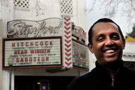 Ash Vasudevan smiles in front of Stanford Theater in Palo Alto, Calif., Thursday February 5, 2015.