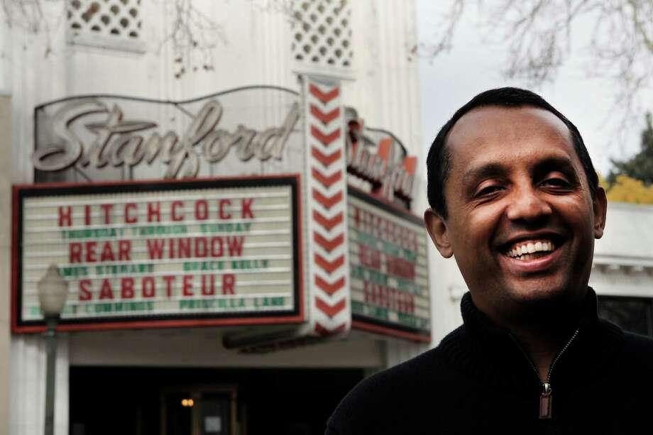 Ash Vasudevan smiles in front of Stanford Theater in Palo Alto, Calif., Thursday February 5, 2015. Photo: Sophia Germer / The Chronicle / ONLINE_YES