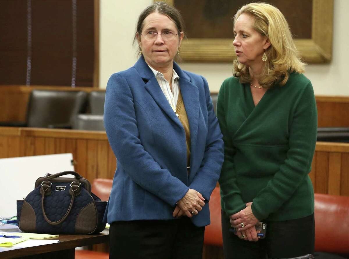 Renee Benson (left) listens to her lawyer Emily Harrison Liljenwal in Bexar County Probate Court on Thursday. Probate Court Judge Tom Rickhoff decided to place the Shirley Benson trust, potentially worth hundreds of millions of dollars, into a receivership controlled by two outside lawyers, former Mayor Phil Hardberger and Art Bayern. as Judge Tom Rickhoff holds a hearing for the second day, concerning Tom Benson's assets. Thursday, Feb. 5, 2015.