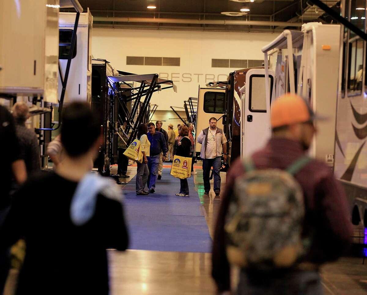 Attendees look over travel trailers on display during the 51st Annual Houston RV Show NRG Center Thursday, Feb. 5, 2015, in Houston. ( James Nielsen / Houston Chronicle )