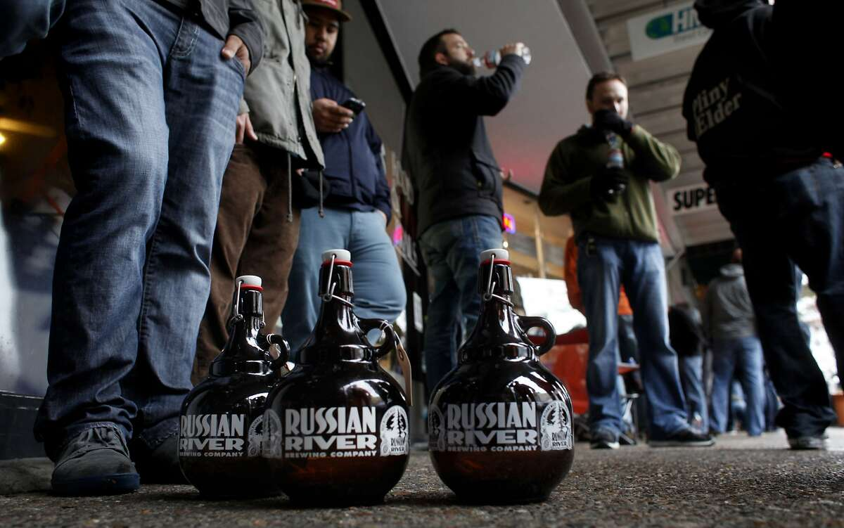 Fans wait outside for hours to be the first to taste Russian River Brewing Company's much-anticipated Pliny the Younger ale, Friday February 7, 2014, in Santa Rosa.