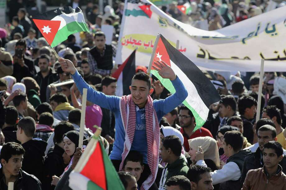 Jordanians chant slogans to show their support for the government against terror during a rally in Amman, Jordan, on Thursday. Jordanian warplanes bombed Islamic State targets in Syria and Iraq. Photo: Raad Adayleh, STR / AP