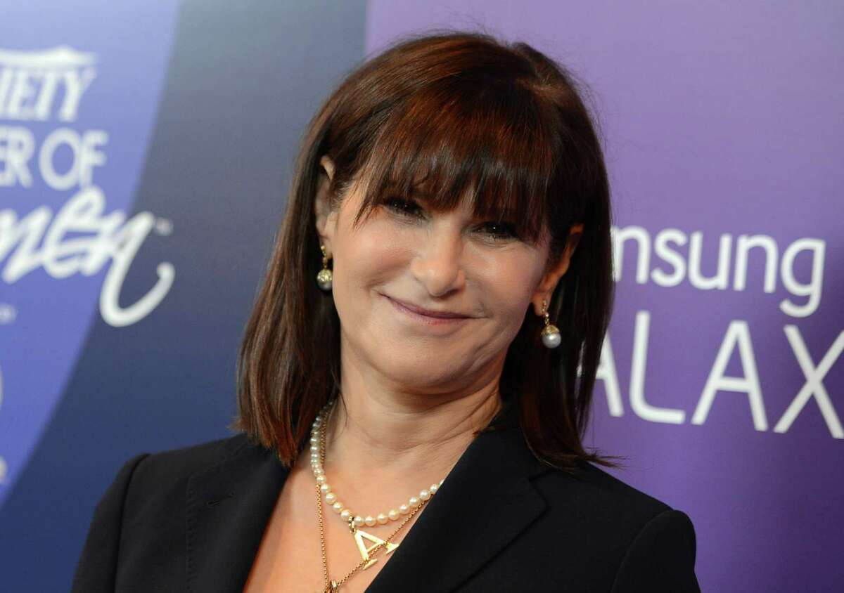 FILE - In this Oct. 4, 2013 file photo, Amy Pascal, Sony Pictures Entertainment co-chairman, arrives at Variety's 5th Annual Power of Women event at the Beverly Wilshire Hotel in Beverly Hills, Calif. Sony on Thursday, Feb. 5, 2015 announced that Pascal will step down as co-chairman of Sony Pictures Entertainment and head of the film studio, nearly three months after a massive hack hit the company and revealed embarrassing emails. (Photo by Jordan Strauss/Invision/AP, File) ORG XMIT: NYBZ156